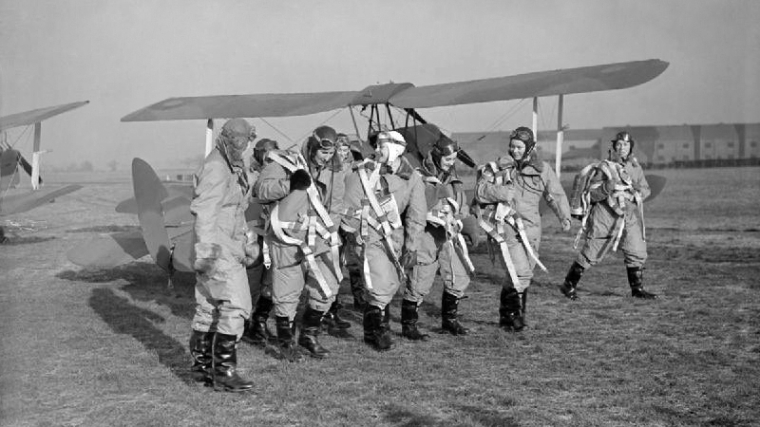 First eight women ATA pilots, Miss Pauline Gower, Commandant of the Women's Section, Miss M Cunnison (partly obscured), Mrs Winifred Crossley, The Hon. Mrs Fairweather, Miss Mona Friedlander, Miss Joan Hughes, Mrs G Paterson and Miss Rosemary Rees. Daventry BJH, Royal Air Force official photographer